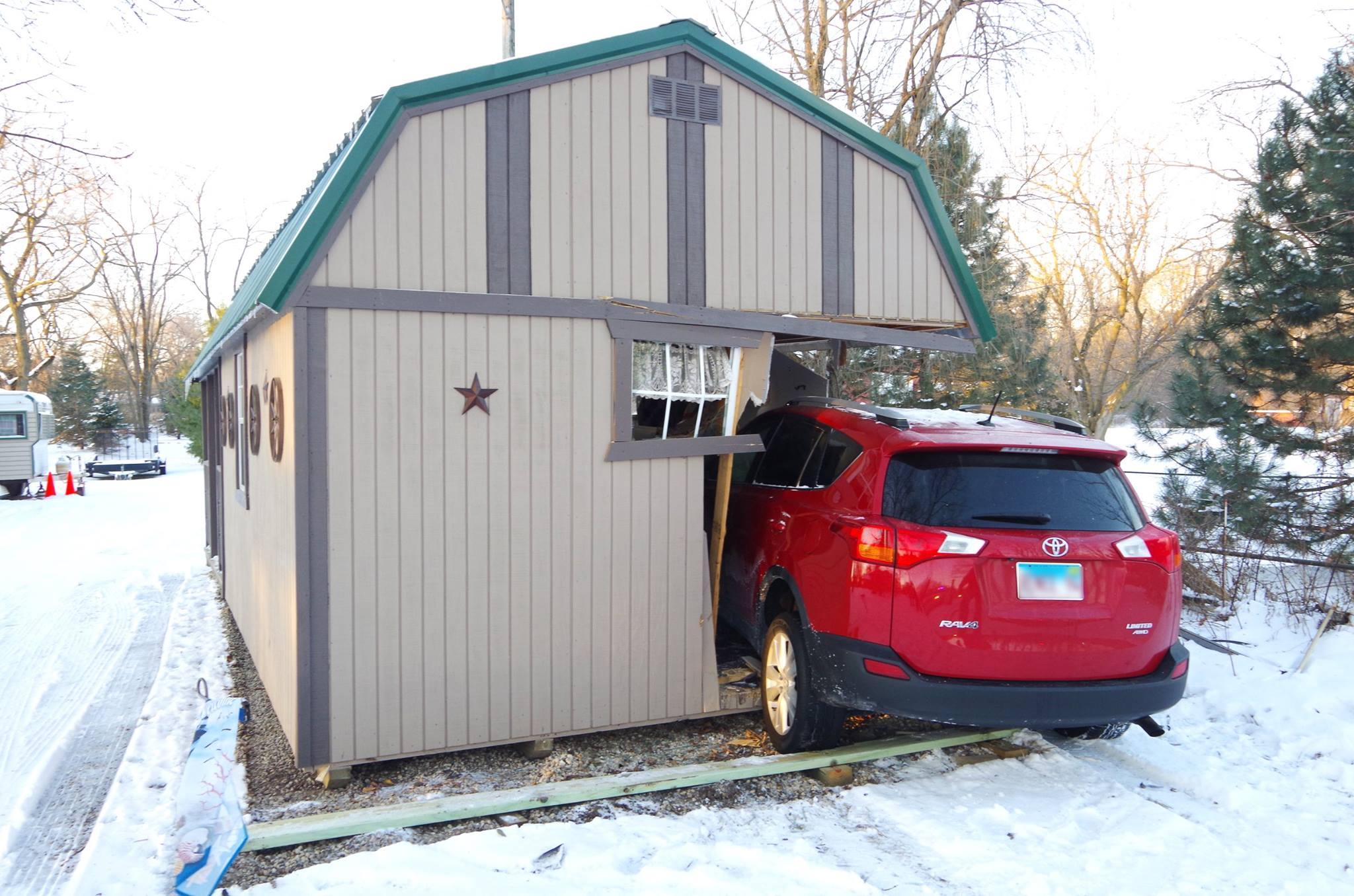 car into shed_1516295865763.jpg.jpg