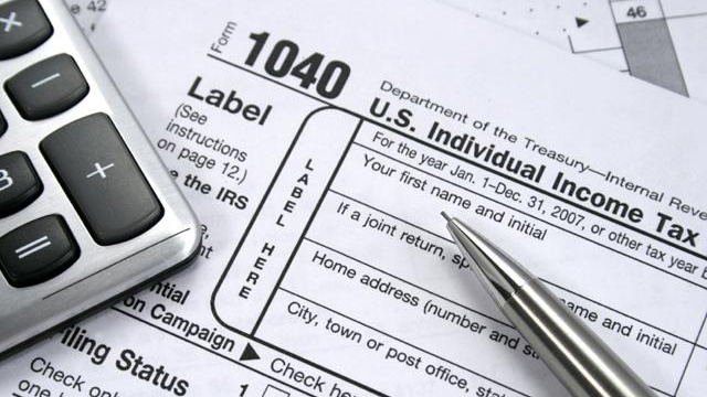 tax forms with pen, calculator, taxes_926795445997885-159532