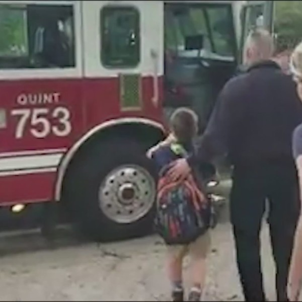 Roscoe 3rd Grader gets a lift to school in fire truck