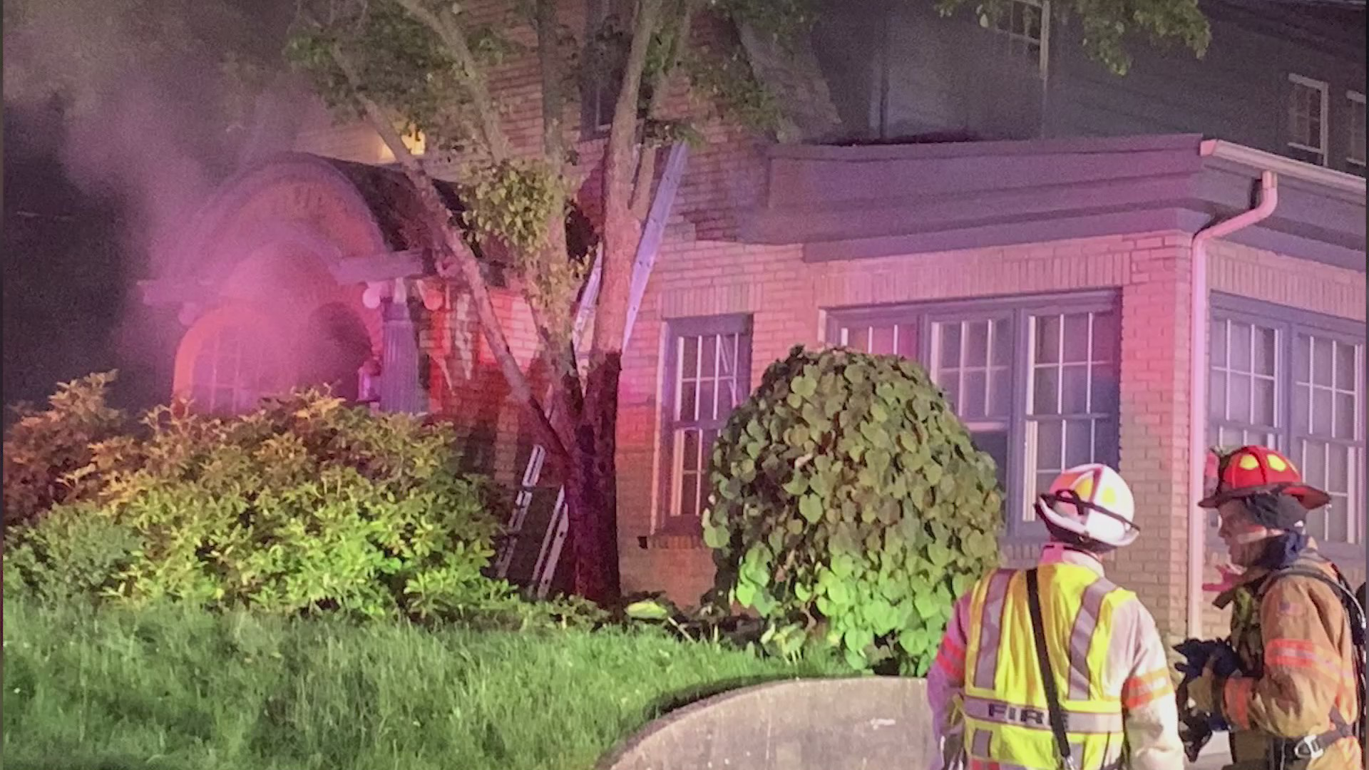 Firefighters rescue two people from roof of burning home